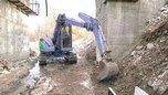 В поселке Партизан борются с наледью на восстановленном после наводнения проезде