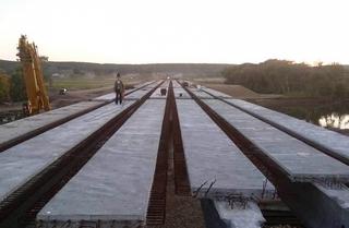 Завершен монтаж балок нового моста в Кроуновке